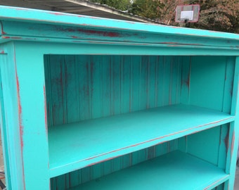 Bookcase turquoise red