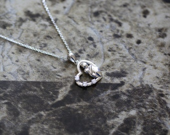 14K white gold diamond heart pendent Mother and child.