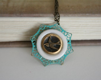 Flying Bird Necklace Bird in flight Teal White Lace - made from vintage buttons