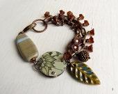 Forage - handmade bohemian-style eclectic artisan bead bracelet in grey, beige, chocolate + forest green - Songbead UK, narrative jewellery