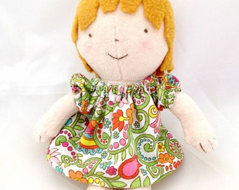 small toddler girl doll with dress, blonde hair