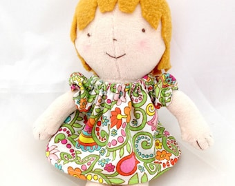 small cloth rag doll with dress, blonde hair