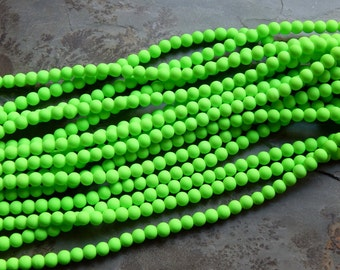 8mm Bright Neon Green Rubberized Glass Beads, 15.5-16 Inch Strand - 50 Beads (IND0C201)