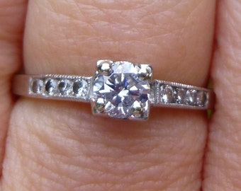 Art Deco   1930s Engagment Ring  SI1 /2 E/F color Diamonds  set in  Platinum  with mil-grain down the sides   Bright Diamonds 50 points