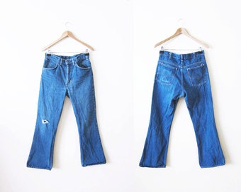70s Levis Bell Bottoms / Orange Tab Levis / 1970s Levi's Flare Jeans / Bohemian Clothing / Ripped Knee