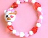 Lalaloopsy Bandage Bear Stretch Bracelet with Red, Pink, and White Heart Beads