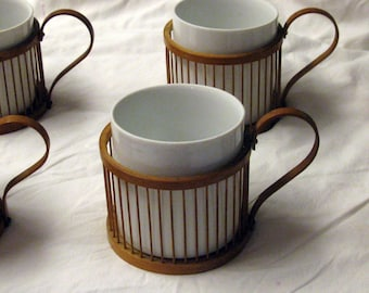 6 Japanese Porcelain tea cups with bamboo, handled holders