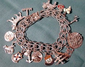 Sterling Silver Double Link Charm Bracelet with 16 Vintage Charms 1960s 1970s