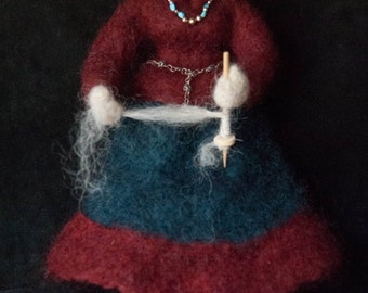 The Navajo Spinner is an original needle felted  art doll.