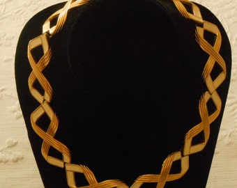Monet.  Gold Tone and Cream Colored Enamel Necklace. (252)
