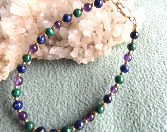 Bracelets done with amethyst, lapis, malachite, 4mm stones, 12k goldfilled bead, lobster clasp, or sterling silver, lobster clasp.
