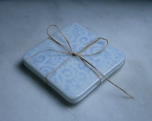 Fused glass. 'Jack Frost'  White snowflakes on pale blue. Ski chalet coasters. Winter holiday coasters. Christmas coasters. Choose 2 or 4.