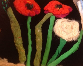 Fiber art wall hanging popey flower red in color