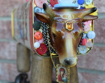 Assemblage Art Cow Steer Sculpture Mixed Media Art Amaretti Virginia Tin Vintage Casters Wisconsin Cow OOAK Original by Laurie Roy Art