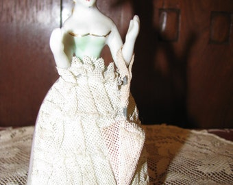 Vintage Porcelain Lady holding an umbrella and wearing a lace hat