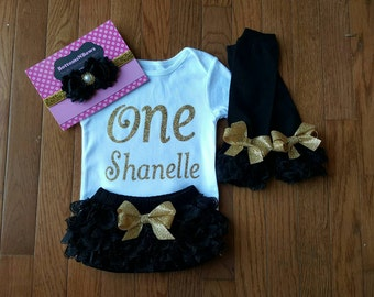"""Gold Glitter Vinyl """"ONE"""" with personalized name bodysuit,Black Lace Bloomers, Leg Warmers, & Headband Set, baby girl,1st Birthday,Cake Smash"""