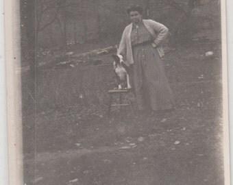 RPPC Photo Poscard Boston Terrier Dog Sitting On Chair Woman Standing Postcard Unused