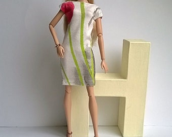 Barbie day dress with light background and floral design