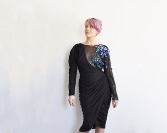 sequin sheer illusion dress . you will win ALL the dance competitions .small.medium .disaster relief .sale