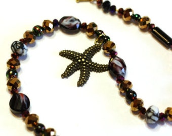 Handmade Starfish Pendant Beaded Necklace with black purple gold and onyx beads