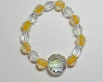 Orange Blossom...a stretch bracelet.  Clear crystal and orange/crystal beads.