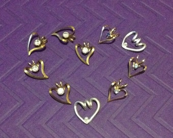 Group of heart shaped charms and pendants