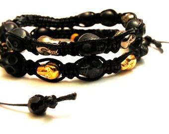 A pair of the Single Row Skull Bead Shamballa Bracelets, Gold/Bronze/Black Skull bead bracelets, Halloween Skull Shamballa Bracelets