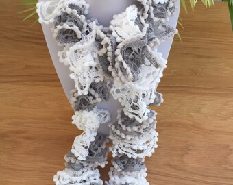 Hand Knitted Multi Hued Grey and White ruffle scarf.