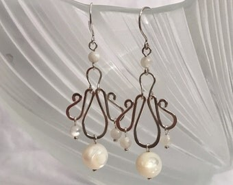 Sterling silver dangling earrings hand wrapped with mother of pearl shell beads
