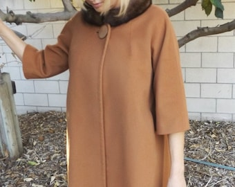Late 1950s rust colored wool swing coat with brown mink collar by Forstmann