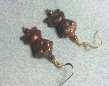 Red brecciated jasper gemstone goldfish bead earrings adorned with dark red Chinese crystal beads.