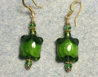 Opaque green Czech glass turtle bead earrings adorned with green crystal beads.