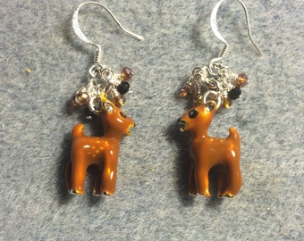 Orangish brown enamel deer charm earrings adorned with tiny dangling orange and black Chinese crystal beads.