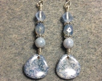 Light blue speckled Czech glass rose petal dangle earrings adorned with light blue Czech glass beads.