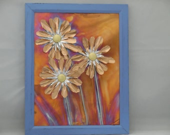 Foil flowers on a torched copper back, in a distressed blue frame