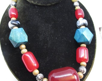 Unusual vintage Tribal style wood and heavy lucite bead necklace.