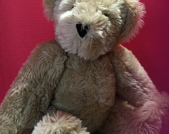 A large Vermont Teddy made in the USA.