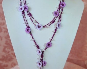 Crocheted necklace with flowers and precious stones
