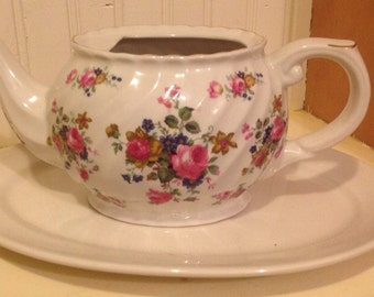 Staffordshire fine earthenware teapot, made in England.