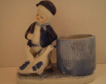 Vintage figurine of boy feeding ducks/geese