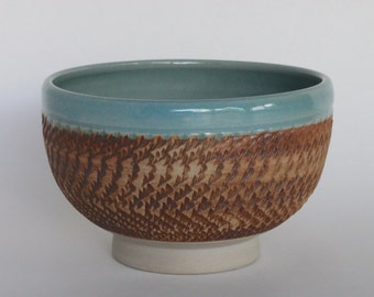 Chattered Ceramic Bowl with Clear Blue Glaze and Iron Oxide Wash
