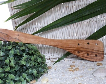 Spatula with holes in olive wood