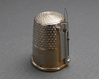 M.T. Pat'd 10 Made in USA thimble with needle threader
