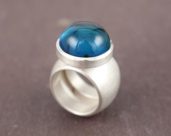 Silver ring with blue amber