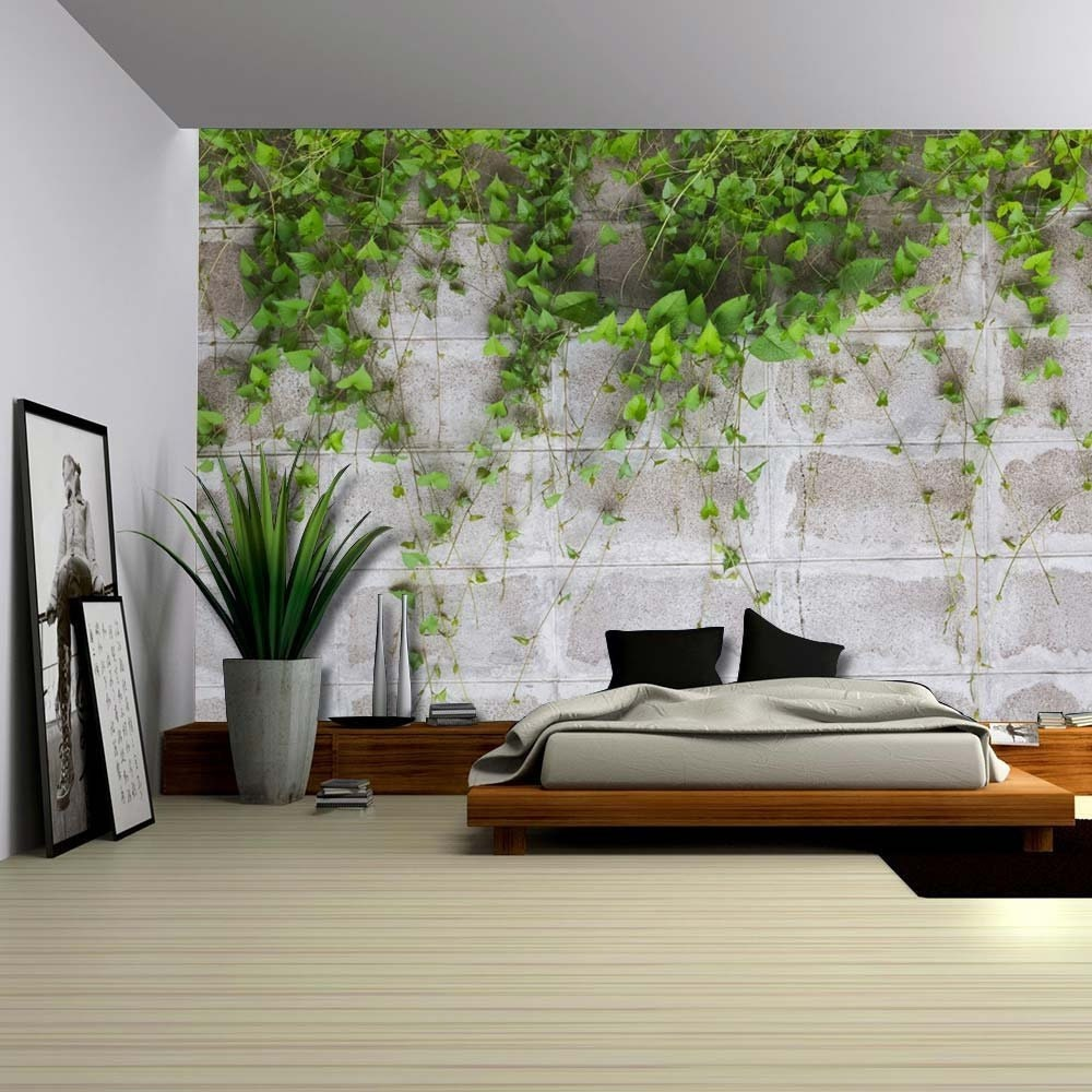 Green Vines Wrapping On A Gray Brick Wall Wall Mural