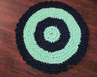 Round crocheted rag rug. It is Navy blue and a real soft light green. Measures 27 ins across. Washable--Shipping included JW77
