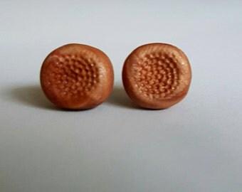 Bronze clay stud earrings.