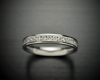 14kt White gold Channel wedding band confort fit with 18 round brilliant diamonds