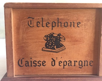 French vintage money box in wood.