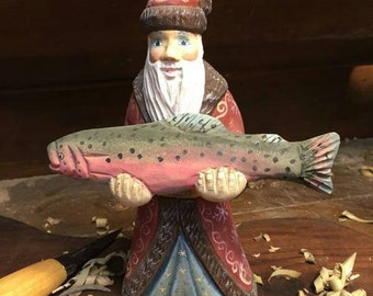 Russian made Fishing Santa hand carved